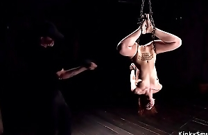 Chained and suspended redhead whipped