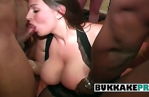 Hot woman is become available interracial bukkake with 7 men while someone takes pictures