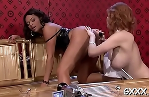 Beautiful lesbian engages in some sexy kissing and dildo play