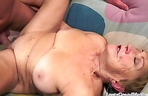 Beamy granny pounded on her back
