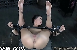 Clamped up girl gets her fuck holes tortured