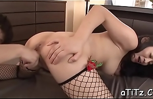 Voluptuous asian stimulates her slit with a strong toy